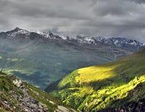 Light shining down on mountain Royalty Free Stock Photos
