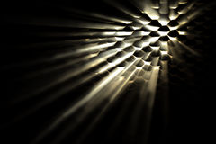Light shining through holes Royalty Free Stock Images