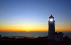 Light Shining in the North Head Lighthouse. On the Washington Coast at Sunset Stock Photos