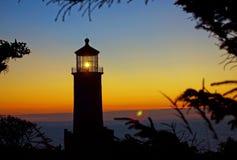 Light Shining in the North Head Lighthouse. On the Washington Coast at Sunset Royalty Free Stock Photo
