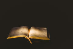 Light shining on open bible Royalty Free Stock Images