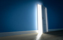 Light shining through open door in dark room with blue walls and Stock Image