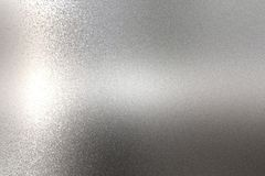 Light shining on rough chrome metal wall texture, abstract background.  stock photography