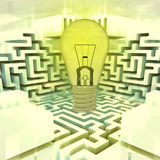 Light shinning bulb above labyrinth Royalty Free Stock Photography