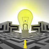 Light shinning bulb with arrow above labyrinth Royalty Free Stock Photo