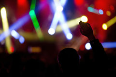 Light Show. At a concert with the silouette of a dancing man with one hand raised in the air in the foreground stock images
