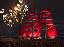 Light show and firework with a frigate with scarlet sails floating on the Neva River. Royalty Free Stock Photo