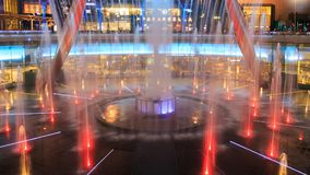 Light show at the Fountain of Wealth, it is the famous place in Suntec City, Singapore stock video