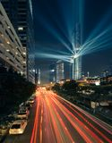 Light show at Mahanakhon building and car light trails. Use two picture blend for light of a car and one for shappen light stock photography