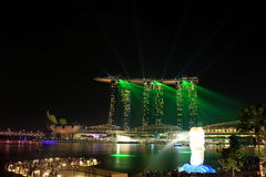 Light show at marina bay sands singapore. Night shot of Marina bay sands in Singapore with light show and merlion statue at sight Stock Photography