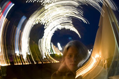 Light show portrait. Portrait of a woman where the background lights was blurred in a circular motion Royalty Free Stock Photography