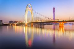 Light show in sunset time at modern bridge in Zhujiang river and modern building of financial district in guangzhou city. China stock images