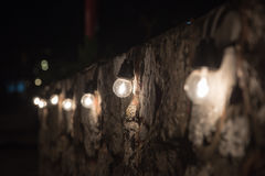 Light side stone wall. On the night Royalty Free Stock Photo