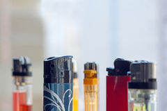 Light_sity. Lot of colored different lighters royalty free stock photo