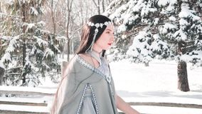Light-skinned frozen warrior not afraid of anything, bravely strides forward, portrait video, fairy-tale character and. Amazing play of actor, elf princess in a stock footage