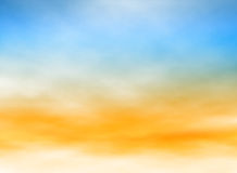 Light sky. Editable vector illustration of high misty clouds in a blue and orange sky made with a gradient mesh Royalty Free Stock Images