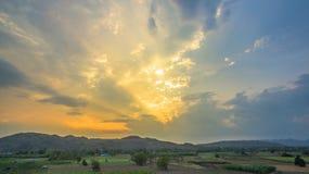 Light through sky above corn fields Stock Photo
