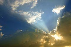 Light and sky. Lighting through the clouds on the sky in evening time Stock Photography