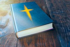 Light from sky . Religion background . Old Testament . Open Bible with Sky . Genesis Book and Creation Sky . Morning Prayer . on a wooden table stock photo