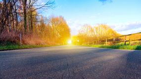Light from sky . Religion background . Road in autumn forest . Religious background . Way to success . Light in dark sky royalty free stock image