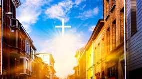 Cross on top of a mountain . Conceptual cross religion shape .  Religion background. Light from sky . Steps leading up to the sun . Way to God . Religious royalty free stock photo