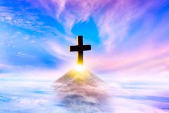 Cross on top of a mountain . Conceptual cross religion shape .  Religion background stock images