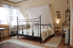 Light sleeping room 2. Light sleeping room with black bed Stock Photo