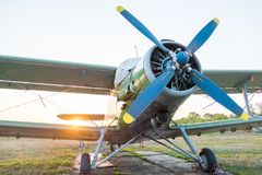 Light small sports airplane AN-2 on the field of the flying club of the parachutists stock photos