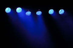 Light and smoke. Lights and smoke. Row of blue lights from a stage Royalty Free Stock Photo