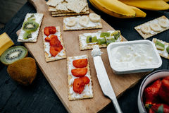 Light snack of water cracker sandwiches with cream cheese and fr Stock Image