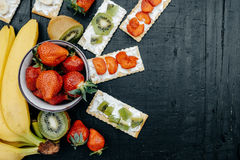 Light snack of water cracker sandwiches with cream cheese and Stock Photo