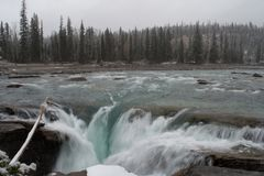 Athabasca Falls. Light snow , in autumn at Athabasca Falls. Jasper National Park stock photo