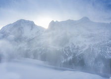 Light snow blizzard in the mountains Stock Photo