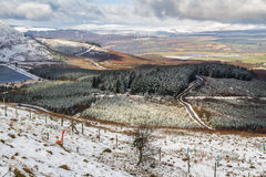 Light snow over fields, hills and trees.  Vale of Neath, South W. Light snow over fields, hills and trees. Looking down on Vale of Neath, South Wales, United Royalty Free Stock Photography