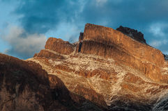Light snow on the Superstition Mountains. The last brilliant rays of sunlight shine on a rare dusting of snow on the Superstitions just outside Apache Junction Royalty Free Stock Image