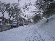 Light snowfall in the neighborhood on a Winters day Stock Photos