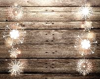 Light snowflakes on a wooden background. stock photography