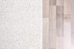 Light soft carpet. On wooden floor royalty free stock photo