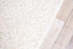 Light soft carpet. On wooden floor royalty free stock image