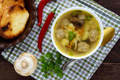 Light soup with dried mushrooms, meatballs and maccheroni in a white bowl Royalty Free Stock Image