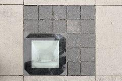 Light source on stone pavement Royalty Free Stock Image