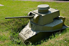 Light Soviet tank in a trench at the position Royalty Free Stock Photo