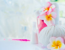 Light Spa background with frangipani flowers and wellness tools. Place for text royalty free stock image