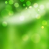 Light sparkles on green. Light defocussed sparkles on green background with bokeh effect Stock Image