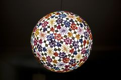 Light sphere with colored embroidery. Of flowers and geometric forms Stock Photography