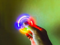 Light spinning on hand Stock Images