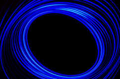 Light spiral and blue lines on a black background Royalty Free Stock Photo