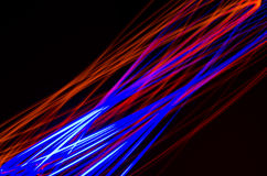 Light spiral, red and blue lines on a black background Stock Photography