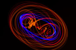 Light spiral, red and blue lines on a black background Royalty Free Stock Image