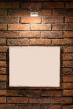 Light spot with a photo frame. Light spot on a wall made of bricks with a photo frame Stock Photo